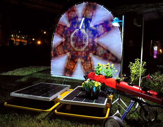 moth tent with solar panels and plants