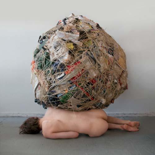 ball of trash on top of naked woman