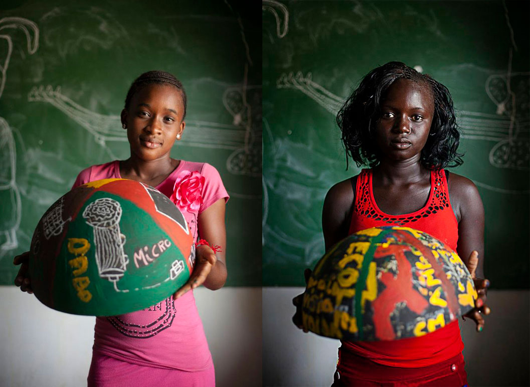 girls from Senegal holding painted bowls