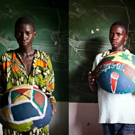 boys from Senegal holding painted bowls