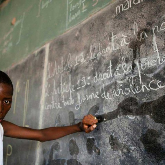 child from Senegal at blackboard