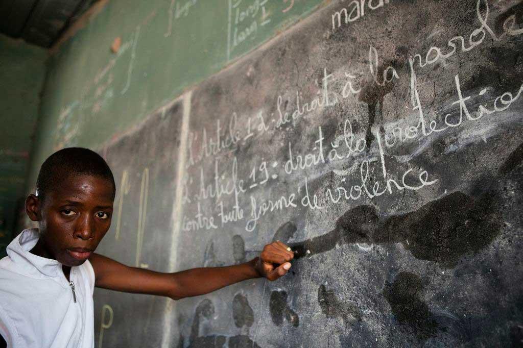child from Senegal at blackboard