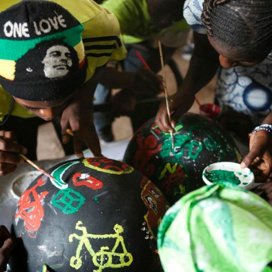 students in Senegal painting bowls