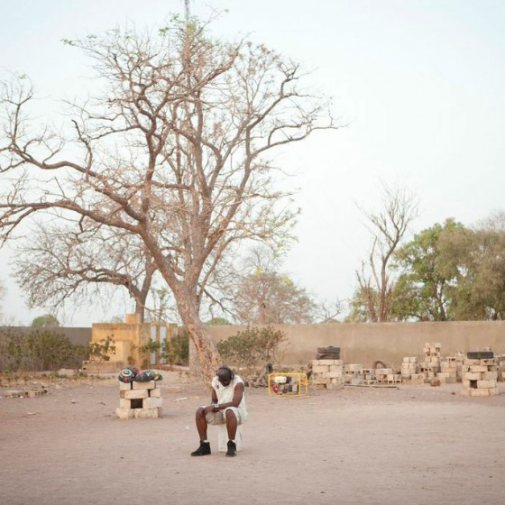 man from Senegal sitting in schoolyard
