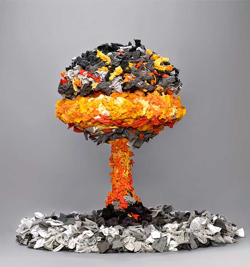 sculpture in form of mushroom cloud made from discarded textiles