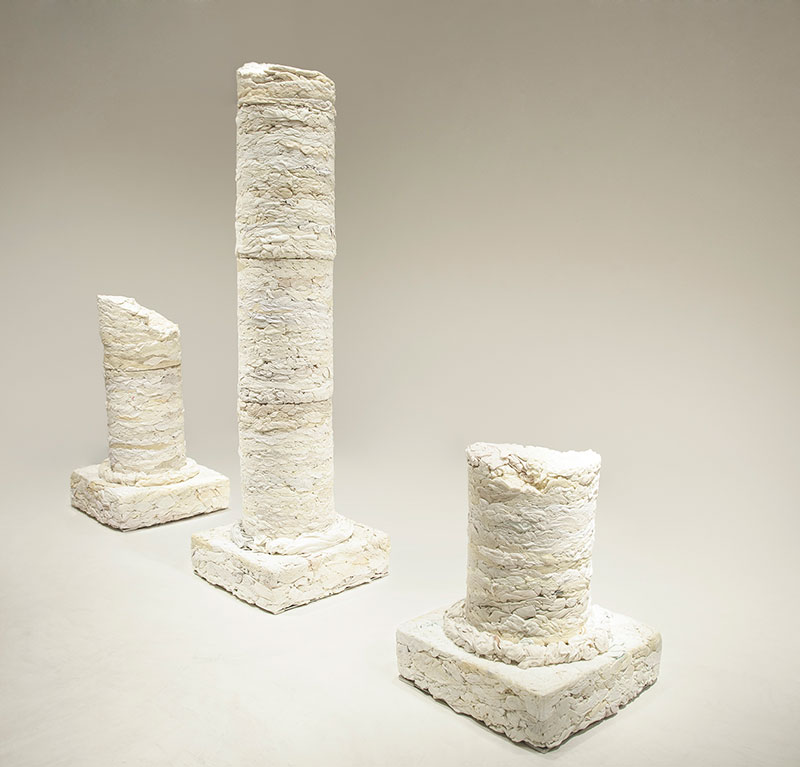 sculpture in form of columns made from discarded textiles