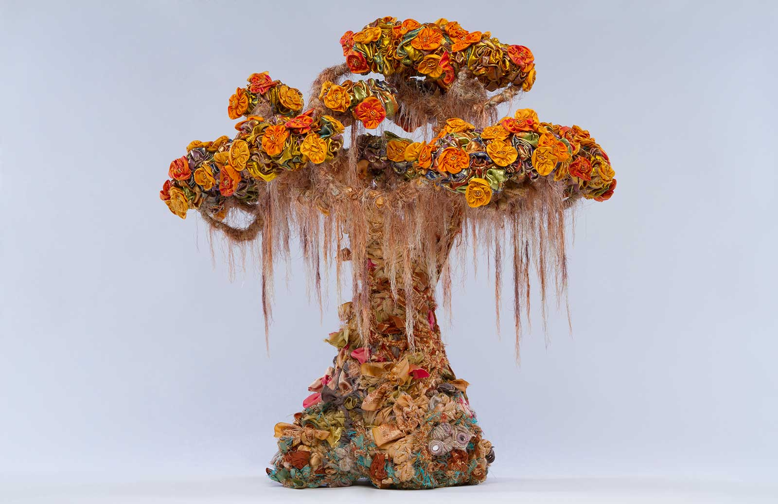 sculpture in form of bonsai tree made from discarded textiles