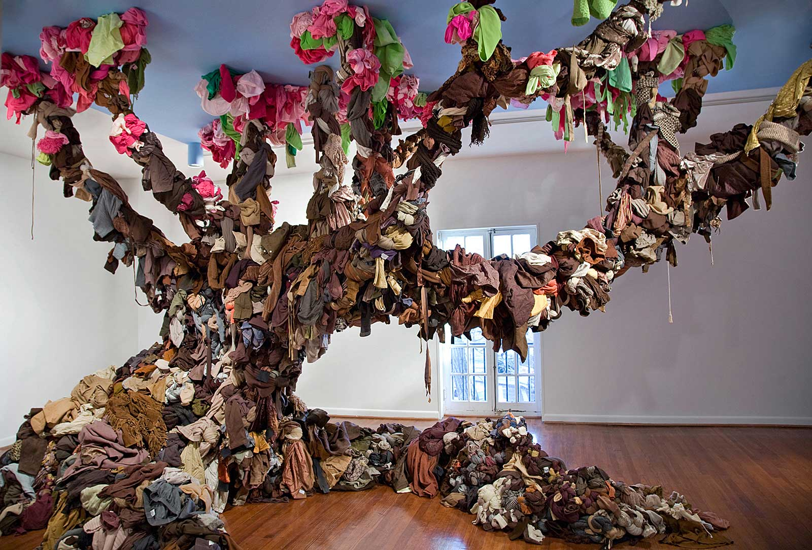 sculpture in form of tree made from discarded textiles