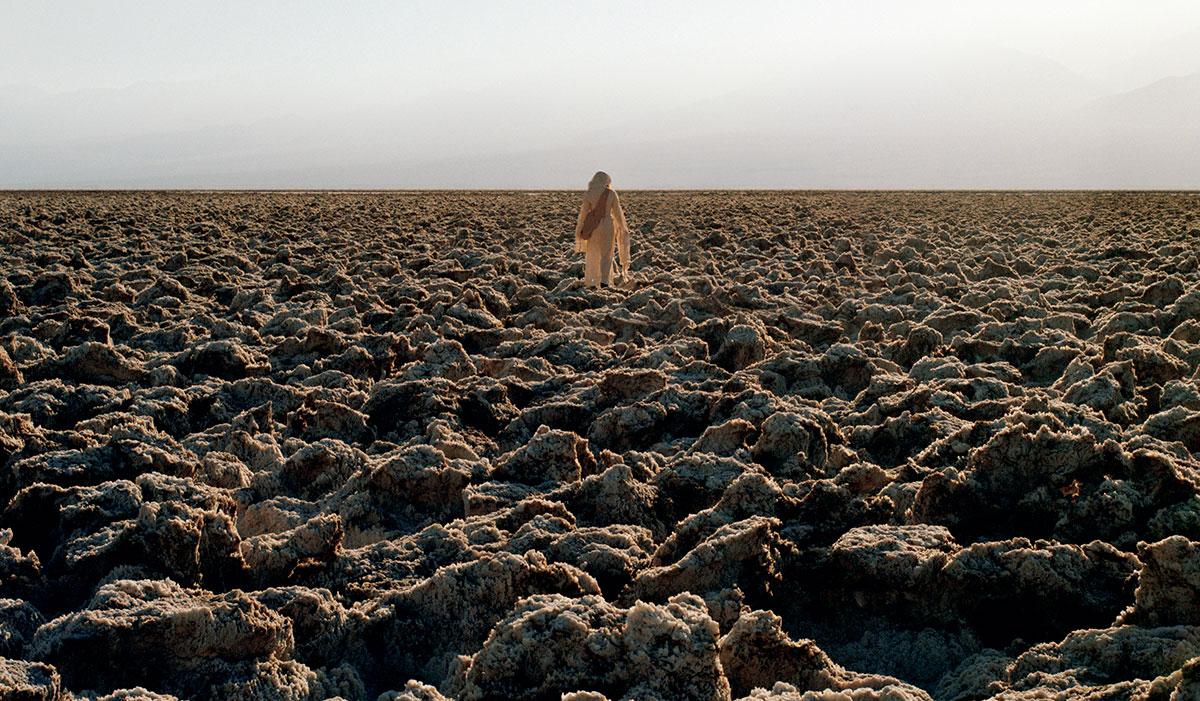woman walking in arid landscape