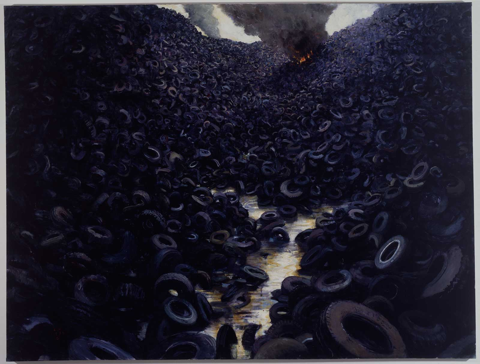 piles of tires with fire