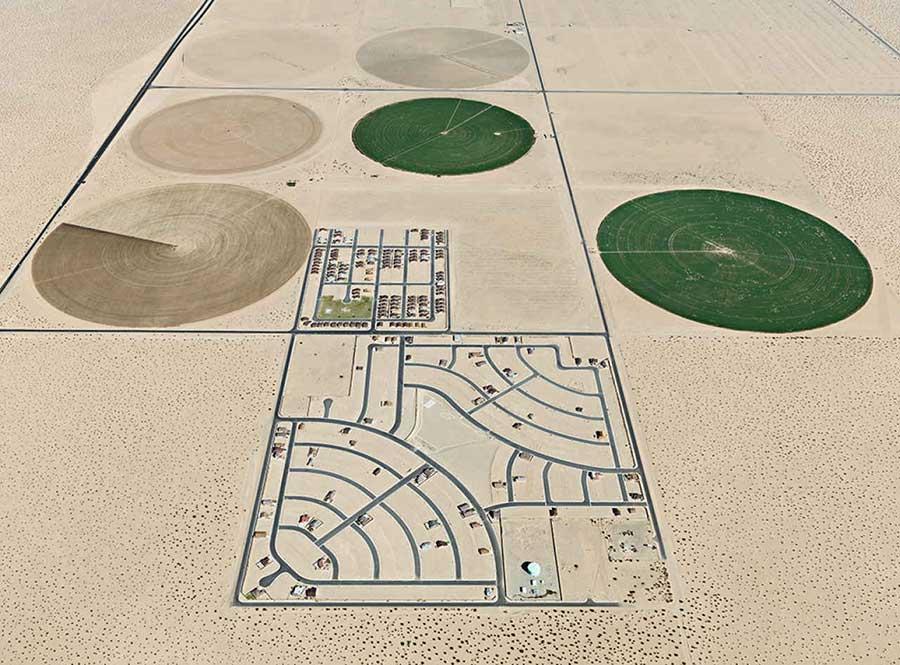 arid landscape with pivot irrigation patterns