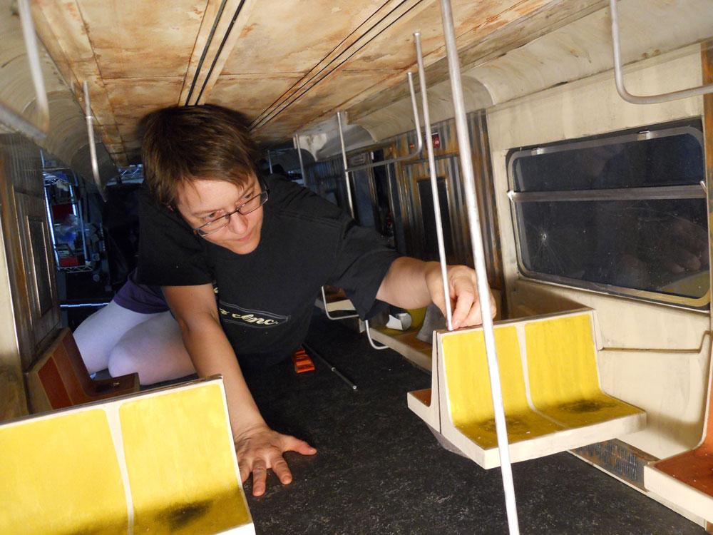 woman in miniature model of subway car