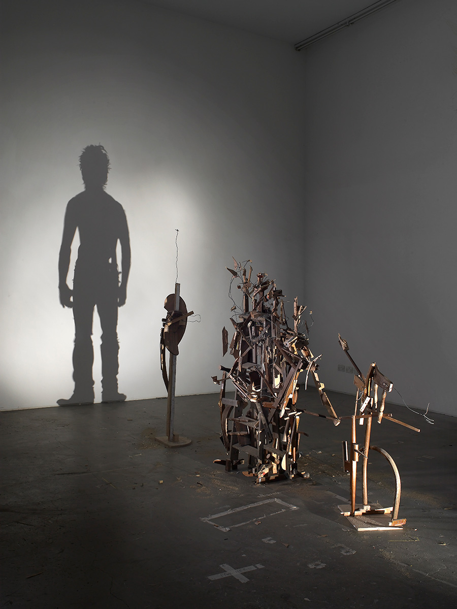figurative shadow art from wood debris