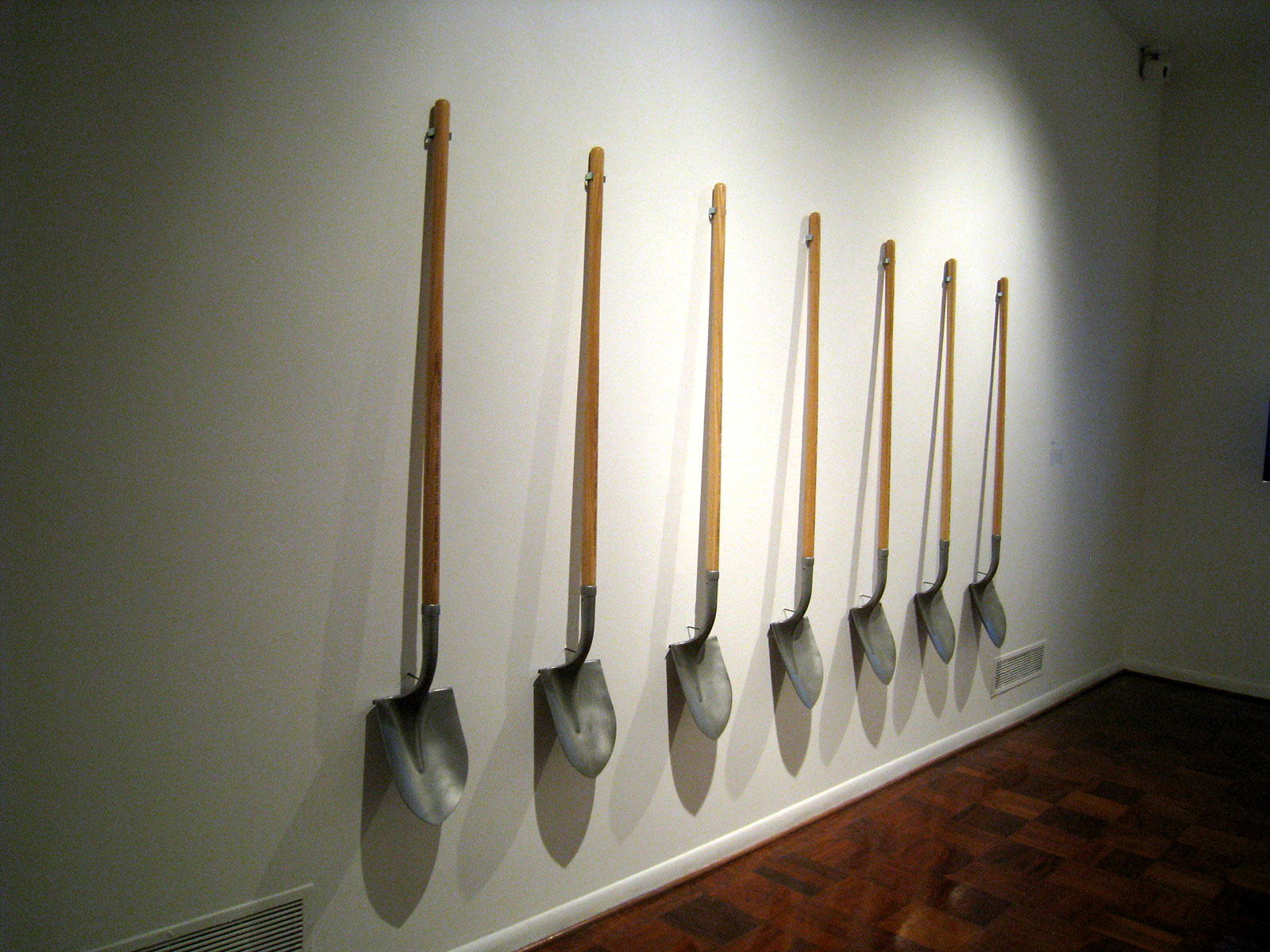 shovels hanging on a wall