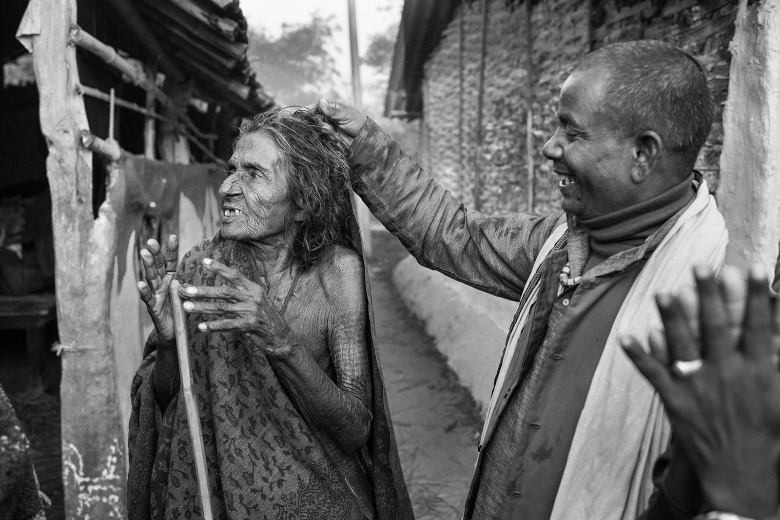 elderly woman in Nepal harassed by man
