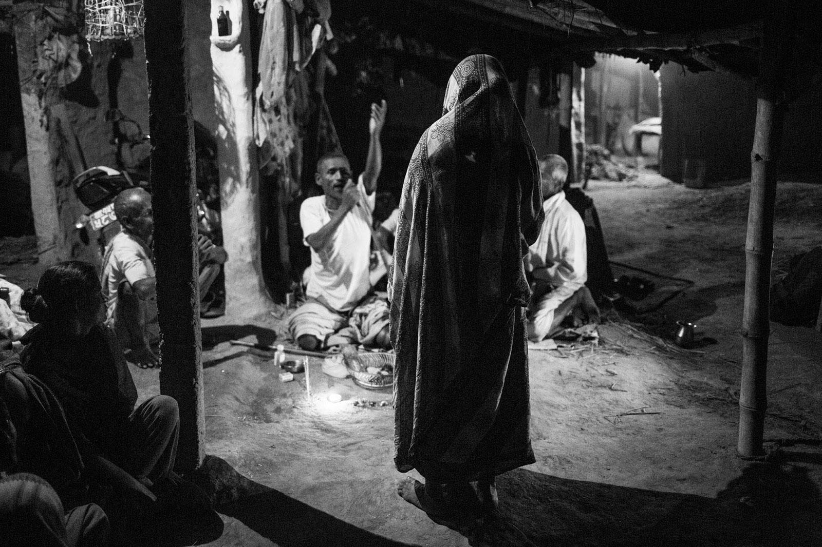 elderly woman in Nepal standing in ceremony