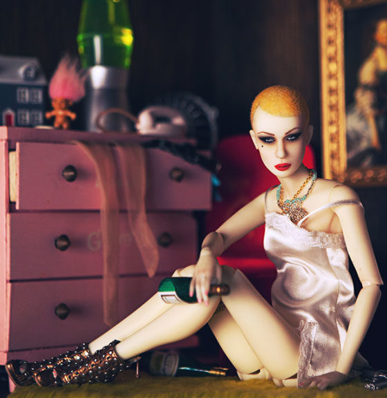 female doll with champagne bottle