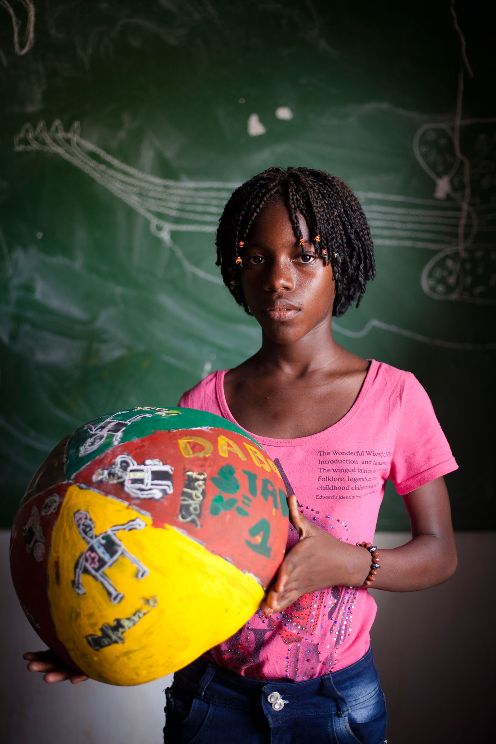 girl from Senegal holding painted bowl