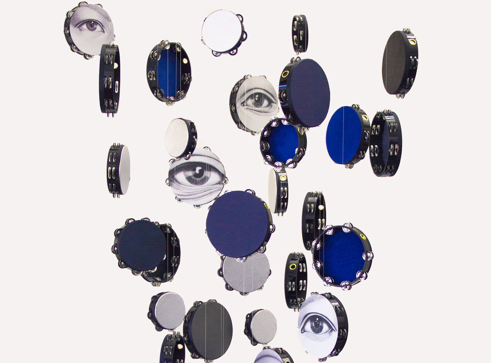 hanging tambourines with painted eyes