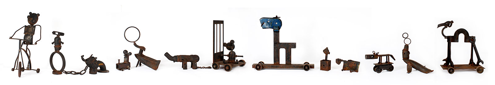 circus animals in bonds made from rusting steel