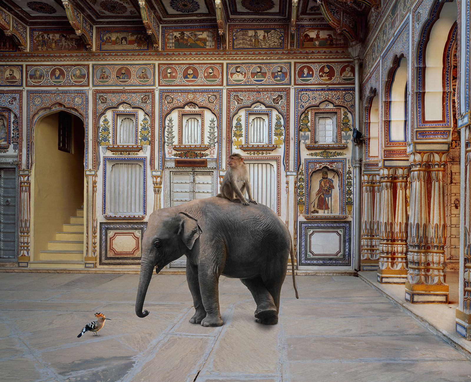 monkey and elephant in ornate Indian temple