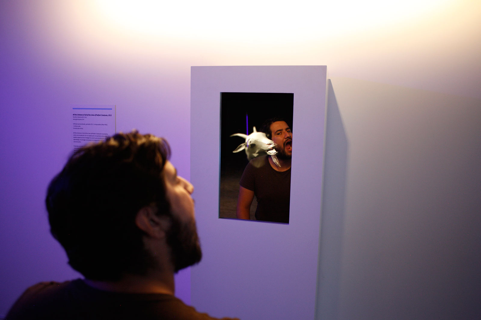 man imitating interactive video of animated goat