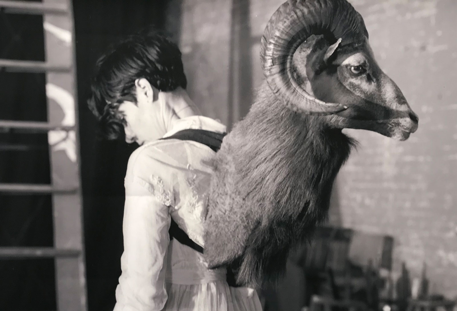 woman with ram's head on her back
