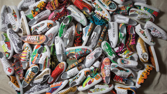 Pile of custom-painted shoes